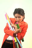 Busy Asian business woman with a lot of colorful papers on background. Stock Image