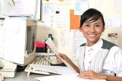 Busy time at office. Girl smile in her busy time at work stock images