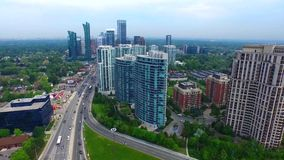 Busy Toronto downtown urban district, skyscrapers and highway in 4k aerial view stock video footage