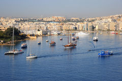 Sliema and harbor, Malta. The busy tourist boats on Sliema waterfront and Marsamxett harbour, Malta, March 2013 Royalty Free Stock Photos