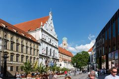 Busy town square with historic buildings stock photography
