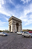 Busy traffic around the famous landmark Arc de Triomphe in Paris. PARIS, FRANCE - OCTOBER 12: Busy traffic around the famous landmark Arc de Triomphe on October Stock Image