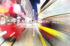 Busy traffic. Blurred motino of tram and double decker in a busy road in Hong Kong Royalty Free Stock Photo