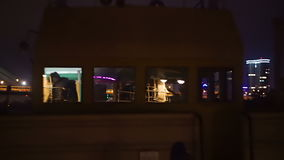 Busy traffic on the bridge at night,  view from deck of an old boat. Busy traffic on the bridge at night, the view from the deck of an old boat hd stock footage