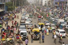 Busy traffic at the central part of the city in Dhaka, Bangladesh. DHAKA, BANGLADESH - FEBRUARY 22, 2014: Busy traffic at the central part of the city on royalty free stock photo