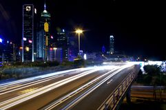 Busy traffic in downtown of Hong Kong. Show the bright side of Hong Kong - Pearl of the East Royalty Free Stock Image