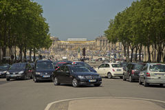 Busy traffic in front of Chateau de Versailles Stock Photography