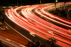 Busy traffic light streaks at night Stock Photo