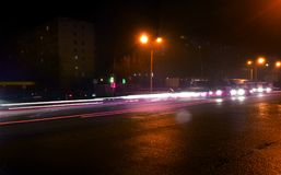 Busy traffic lights on rush hour at night Royalty Free Stock Photos