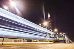 Busy traffic on the London Bridge at Night, Time-Lapse. Traffic on the London Bridge at Night with the Shard at the Background Stock Photo
