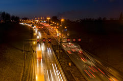 Busy traffic at night. Cars on the highway at night Royalty Free Stock Image