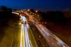 Busy traffic at night. Cars on the highway at night Royalty Free Stock Photography