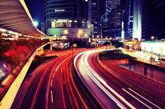 Busy Traffic at night - Hong Kong. Busy Traffic at night, in Central, Hong Kong Royalty Free Stock Images