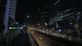 Busy traffic on night roads of Bangkok, Thailand. Night view of Bangkok street with transport traffic on highway and highrise buildings alongside, Thailand stock video