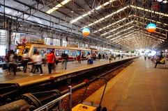 Local train station in Mumbai, India. A busy train station in Mumbai, India stock photography