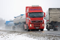 Busy Truck Traffic in Snowfall Stock Photo