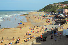 Busy UK beach. Stock Photos