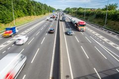 Busy UK Motorway. An aerial view of a busy motorway with speeding traffic on both carriageways Royalty Free Stock Photos