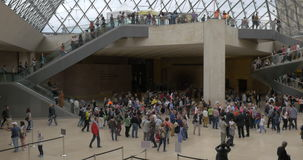 Busy underground lobby of Louvre Pyramid stock footage