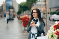 Woman with Smartphone and Shopping Bag Walking on the Street Stock Photo