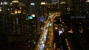 Busy urban traffic jam at night,Brightly lit urban morden building background. Freeway busy city rush hour heavy traffic jam highway Shanghai at night,Brightly stock video footage
