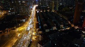 Busy urban traffic jam at night,Brightly lit urban morden building background. Freeway busy city rush hour heavy traffic jam highway Shanghai at night,Brightly stock video