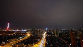 Busy urban traffic at night,Brightly lit urban morden building background. Freeway busy city rush hour heavy traffic jam highway Shanghai at night,two parallel stock video footage