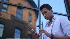 Busy Using Smartphone, Standing Young Black Male Designer stock video