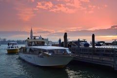 Busy Venice port at sunset Stock Photos