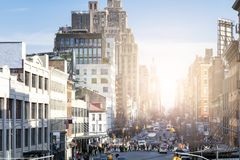 Busy view of 14th Street with crowds of people in Chelsea New York City. Busy view of 14th Street with crowds of people and sunlight background scene from the royalty free stock photos