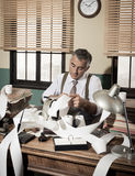 Busy vintage accountant with calculator royalty free stock image