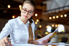 Busy White Collar Worker at Coffeehouse Stock Image