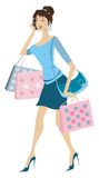 Busy woman. Young busy woman holding shopping bags phoning Stock Photos