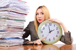 Busy woman. With clock on white Royalty Free Stock Photos