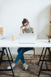 Busy woman designer having lunch in office. Royalty Free Stock Image