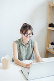 Busy woman designer having lunch in office. Royalty Free Stock Images