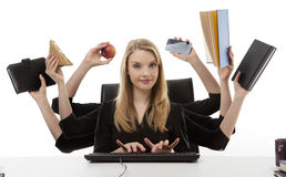 Busy woman at her desk royalty free stock photo
