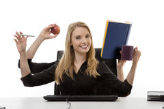 Busy woman at her desk Royalty Free Stock Image
