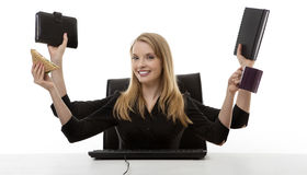 Busy woman at her desk Stock Photography
