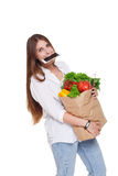 Busy woman hold bag with healthy food, grocery buyer isolated Royalty Free Stock Photos