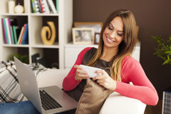 Busy woman at home Royalty Free Stock Image