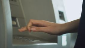 Busy woman inserting credit card into atm to check her balance, easy banking. Stock footage stock video footage