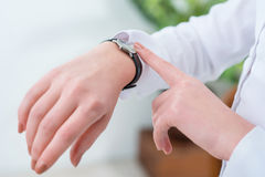 Busy woman looking at her wrist watch Royalty Free Stock Photography