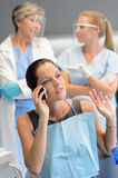 Busy woman patient calling at dentist office Royalty Free Stock Photos