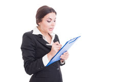 Busy woman supervisor writing on clipboard Royalty Free Stock Image