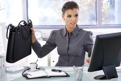 Busy woman working in bright office Stock Photography