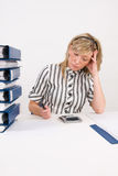 Busy woman working at desk Royalty Free Stock Photography