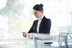 Busy woman working on her laptop Stock Image