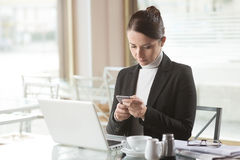 Busy woman working with her laptop Stock Photography