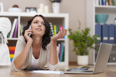 Busy woman working at home Stock Image